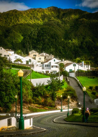 garden settlement: White homes in Furnas town, which lies in the volacano crater, Sao Miguel, Azores, Portugal