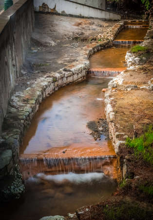 vulcanology: Stream with geothermal hot mineral water in Furnas, Sao Miguel, Azores, Portugal Stock Photo