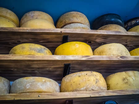 produced: Large smelly cheese on sale in a shop selling locally produced food, Ponta Delgada, Sao Miguel, Azores, Portugal