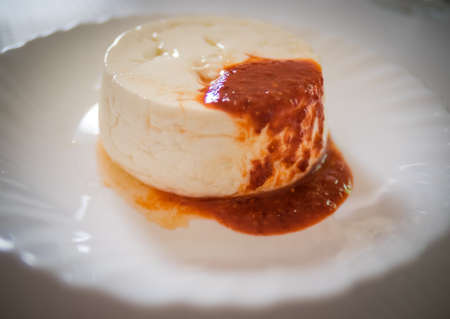 speciality: Queijo Fresco - a unique and delicious speciality of the Azores - cheese served with slightly spicy sauce based on tomatoes and chili Stock Photo