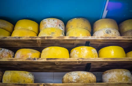 stocked: Large smelly cheese on sale in a shop selling locally produced food, Ponta Delgada, Sao Miguel, Azores, Portugal