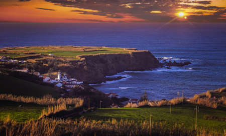 stunningly: Beautiful sunset over cliffs of the stunningly beautiful coastline of Sao Miguel Island in the Azores, Portugal Stock Photo