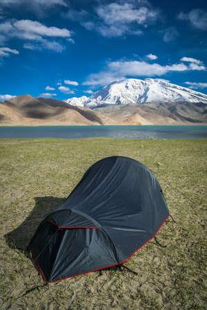 pitched: Pitched tent at the stunning Kara Kul lake, China Stock Photo