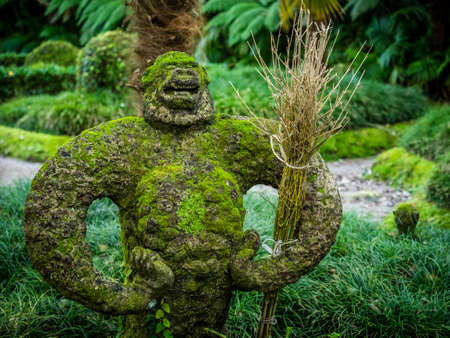 fern  large fern: Proud monkey moss covered sculpture in The Terra Nostra Garden in Furnas,  on Sao Miguel island, Azores, Portugal Stock Photo