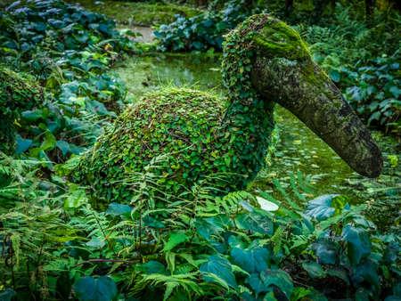 terra: Moss covered bird sculpture in The Terra Nostra Garden in Furnas,  on Sao Miguel island, Azores, Portugal Stock Photo