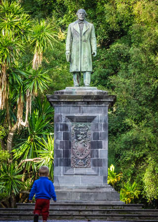 canto: Little boy under the sculpture in the Jos� do Canto Botanical Garden in Ponta Delgada, the capital of Sao Miguel island, Azores, Portugal