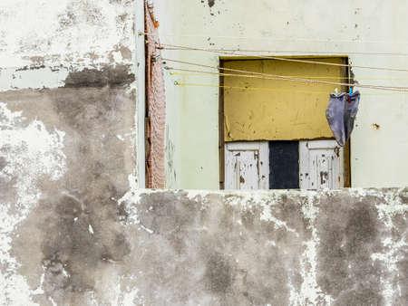 neglected: Old grungy neglected home facade in Ponta Delgada, Sao Miguel, Azores, Portugal