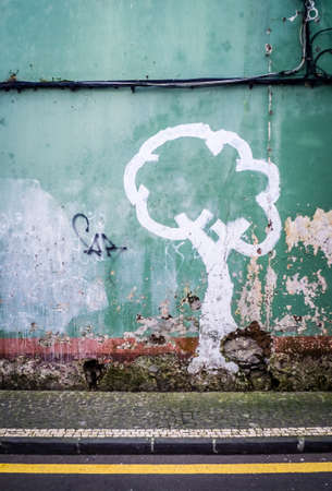 grungey: Graffiti art on the wall of an old home in Ponta Delgada, Azores, Portugal Stock Photo