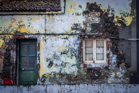 neglected: Old grungy neglected home detail in Ponta Delgada, Sao Miguel, Azores, Portugal Stock Photo