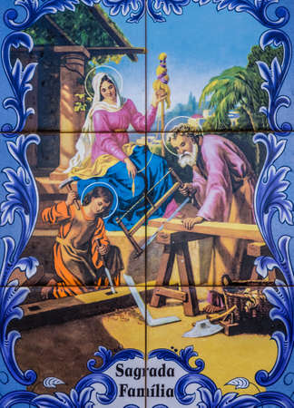 depicting: Porcelain plaque depicting the Holy Family on the wall above door in the Ponta Delgada town in Sao Miguel, Azores Island, Portugal