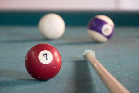 billard: Billard ball with lucky number seven on a green billard table
