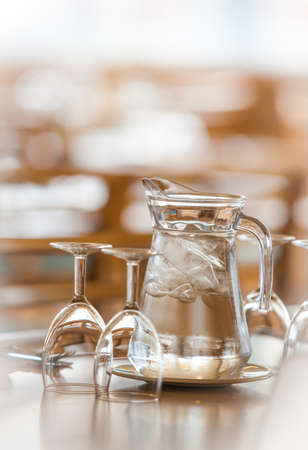 jag: Jag of tap water and glasses on the table before wedding dinner reception Stock Photo
