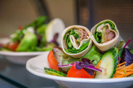 hoisin: Duck wrap on display in self service hotel canteen