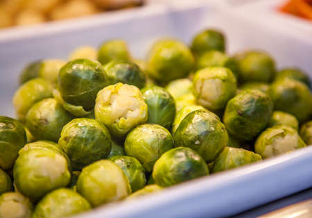 lunch tray: Cooked green small brussel sprouts on a tray on the hot counter in a self service hotel lunch canteen