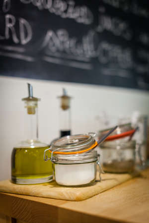 additives: Table with condiments and additives like oil, vinegar, sugar, etc, in a student canteen