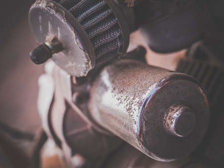 slits: A view of the detail of an engine of an old vintage and antique car Stock Photo