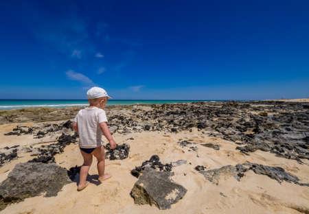 corralejo: Little boy walking on a beach in Corralejo, Fuerteventura, Canary Islands, Spain
