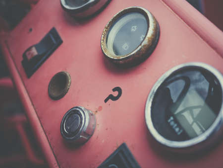 the outmoded: A view of the dashboard or instrument panel of an old vintage and antique car