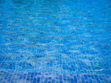 squared: Water in the swimming pool with squared pattern floor tiles