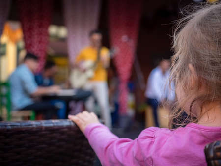 and four of the year: Four year old caucasian girl watching street band playing music during festival in Fuerteventura, Canary Islands, Spain