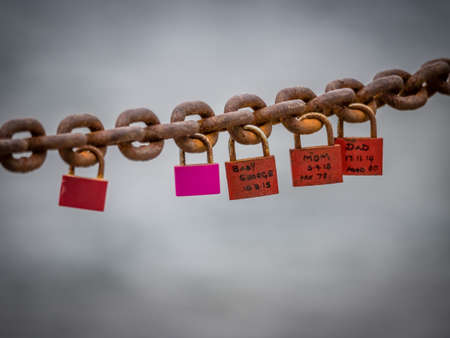 initials: Padlocks with lovers names and initials attached to a chain on the promenade in Playa Blanca, Lanzarote, Canary Islands, Spain. Picture taken 18 April 2016