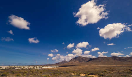 Pico de Redondo volcano and the homes and resorts of Playa Blanca town in southern Lanzarote, Canary Islands, Spain