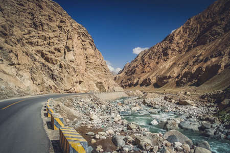 paved: Paved mountain road through the gorge in Western Tibet Stock Photo
