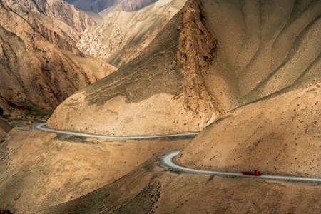 stunningly: Chinese truck struggling and moving slowly on the stunningly beautiful mountain road through the Western Tibet, China Stock Photo