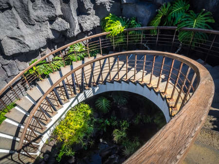 Lanzarote, Spain -  August 22, 2016:  Winding stairs leading to the underground corridor in the Cesar Marique Foundation in Tahiche, Lanzarote, Canary Islands, Spain