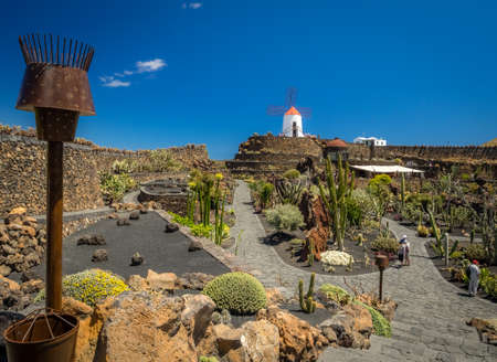 manrique: Lanzarote, Spain -  August 22, 2016: People visiting the old windmill turned museum in the Cactus Garden designed by Cesar Manrique, Lanzarote, Canary Islands, Spain