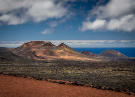 Volcanic landscape of the Timanfaya National Park ( also called The Montanas del Fuego or Mountains of Fire ) in Lanzarote, Canary Islands, Spain Stock Photo
