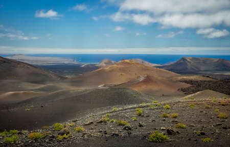 surrealistic: Volcanic landscape of the Timanfaya National Park ( also called The Montanas del Fuego or Mountains of Fire ) in Lanzarote, Canary Islands, Spain Stock Photo
