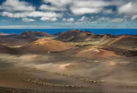 timanfaya: Volcanic landscape of the Timanfaya National Park ( also called The Montanas del Fuego or Mountains of Fire ) in Lanzarote, Canary Islands, Spain Stock Photo