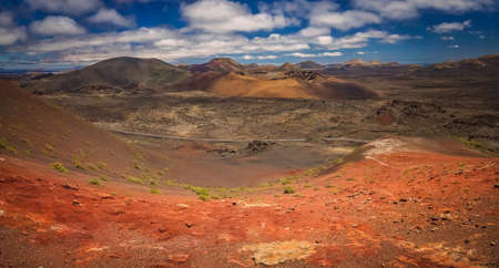 surrealistic: Panoramic view of the Timanfaya National Park ( also called The Montanas del Fuego or Mountains of Fire ) in Lanzarote, Canary Islands, Spain