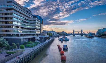 warship: The beautiful sunrise behind the Tower Bridge and the HMS Belfast warship, London, England, UK Stock Photo