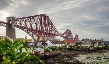 Homes under the Forth Rail Bridge in Edinburgh, Scotland, connecting the towns of North and South Stock Photo