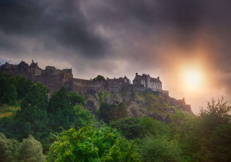princes street: Royal Castle on a rocky hill in Edinburgh, Scotland, UK