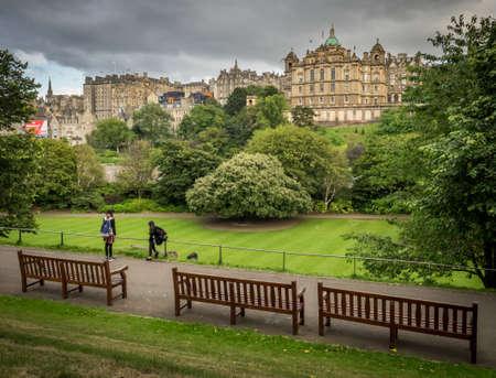 princes street: Edinburgh, Scotland -  30 August 2016 :  People sitting on a bench in East Princes Street Gardens