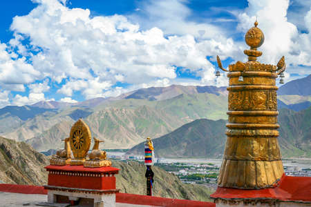 View of the golden deer and dharma wheel, the wheel of life, at the Jokhang Temple in Lhasa, Tibet Stock Photo