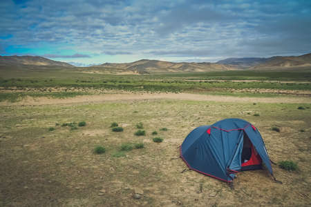 pitched: Tent pitched on the meadow in Central Tibet Stock Photo