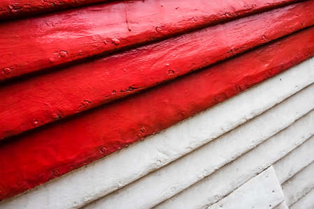 ship bow: Red and white rows of painted wooden side of a fishermen boat