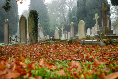 High Wycombe, England - October 30, 2016: English cemetery on a cloudy, misty and foggy autumn day