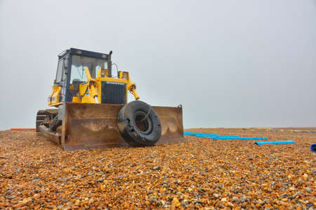 Hastings, England - December 30, 2016: Bulldozer on the stony beach in Hastings, East sussex,  England Editorial
