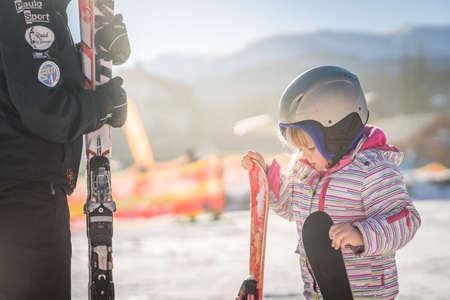 Szklarska Poreba, Poland -  February 2017 :  Little girl learning to ski taught by experienced female ski instructor, Szklarska Poreba, Karkonosze mountains, Poland