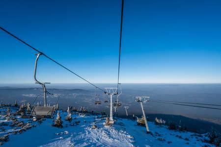 Ski lift up to the top of the Szrenica mountain in Szklarska Poreba resort town, Karkonosze mountains, Poland Stock Photo