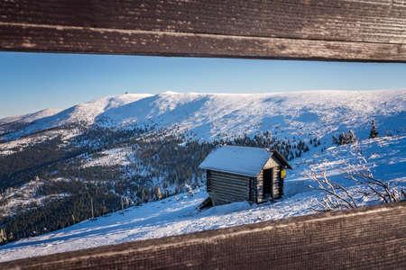 Small wooden hut on the slope of Szrenica mountain in Szklarska Poreba, Karkonosze mountains, Poland Stock Photo