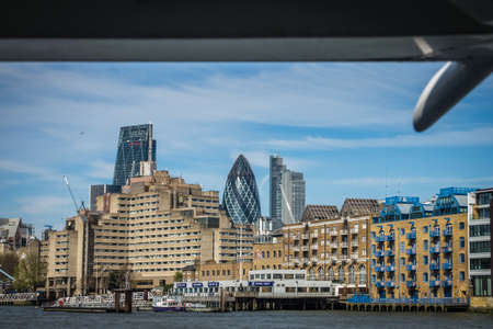 prestigious: London, England -  25 March 2017 : Residential and commercial buildings as seen from the river Thames, London, UK