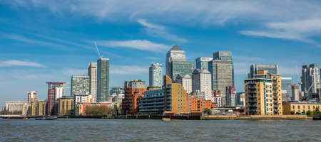 London, England -  25 March 2017 : Panorama of Canary Wharf commercial buildings as seen from the river Thames, London, UK