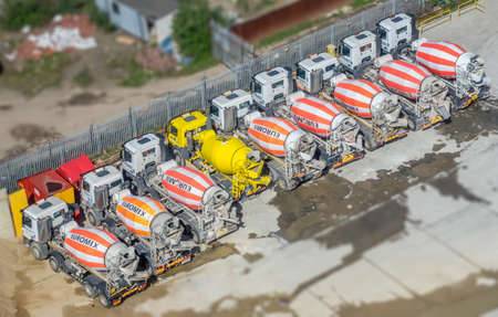 London, England -  25 March 2017 : Parking with Concrete mixing trucks seen from above, London building site