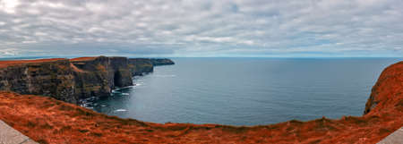 Panoramic view over Cliffs of Moher on a overcast, cloudy and gloomy day, Ireland